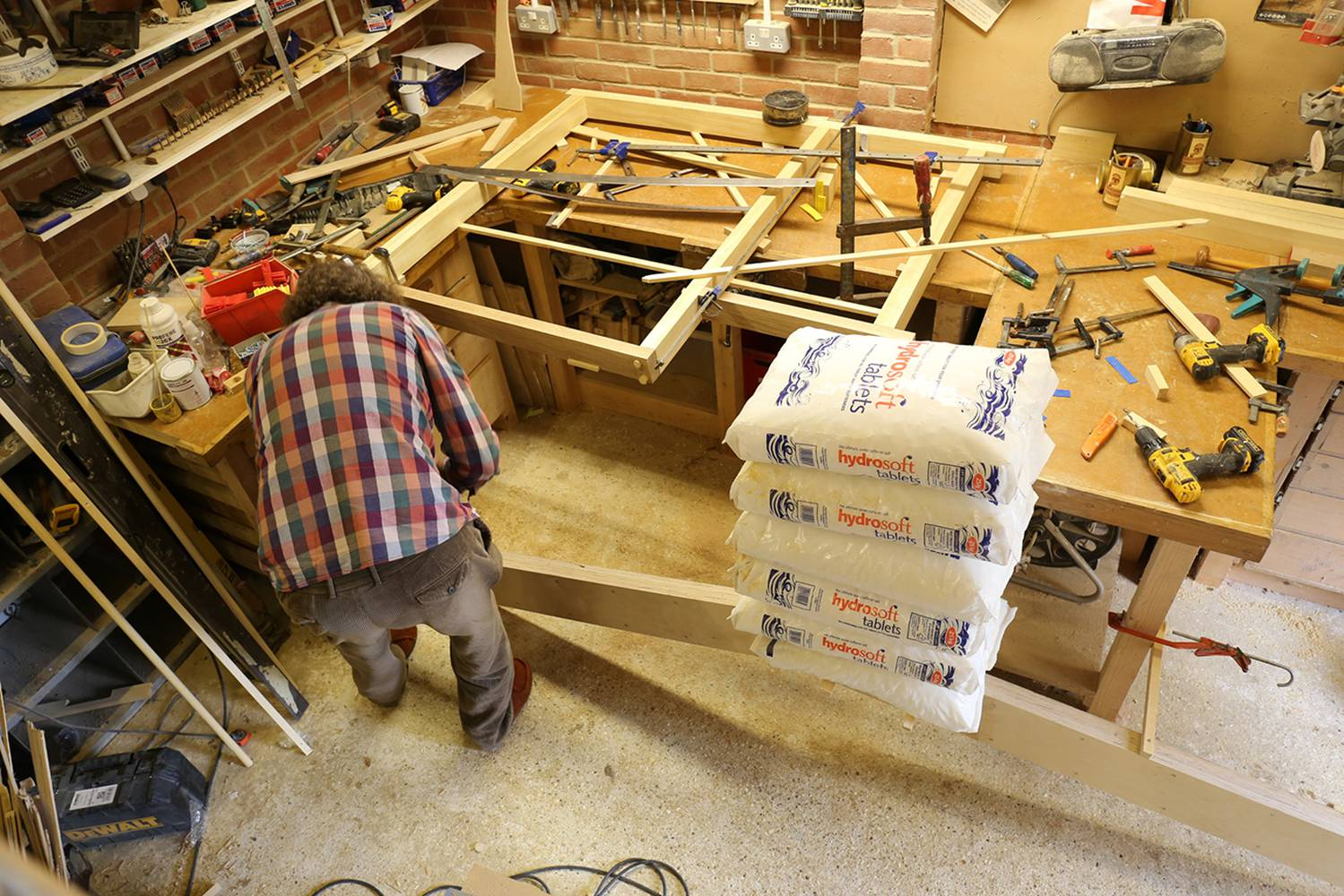 <p>The client, and self-builder Stuart load testing laminated plywood cranked roof beams to demonstrate structural preformace. </p>